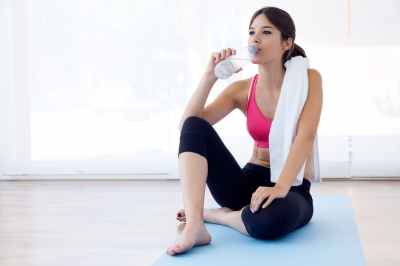 Beautiful Young Woman Drinking Water After A Workout At Home - nenetus